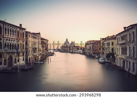long time exposure of canal grande in Venice (Venezia) - Santa Maria Della Salute, Church of Health in dusk twilight at Grand canal Venice, Italy, Europe, vintage filtered style - stock photo