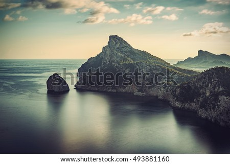 Long time exposure of El Colomer at Cap de Formentor peninsula, Majorca (Mallorca), Balearic islands, Spain, Europe, Vintage filtered style