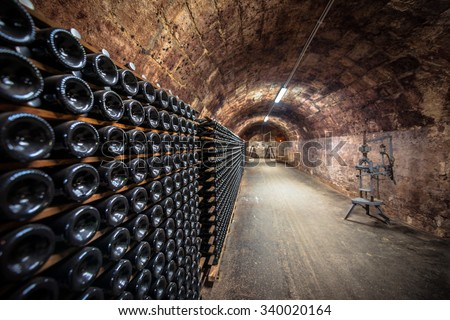 Long underground brick tunnel angle shot dark - stock photo