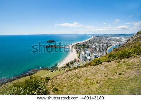 Long white beach of Mount Maunganui stretching to horizon from northern slopes of landmark mountain.