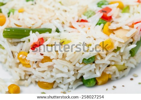 Long white rice with vegetables. As a whole background.