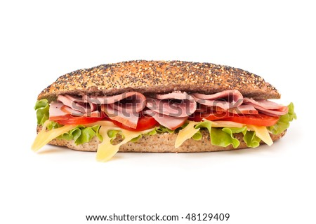 long whole wheat baguette sandwich with lettuce, tomatoes, ham, turkey breast and cheese - stock photo