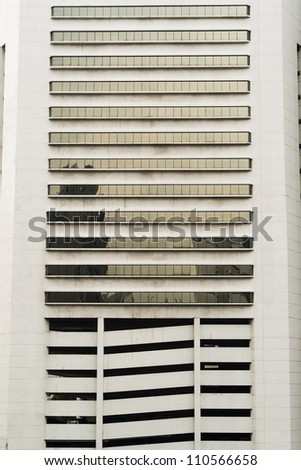 Long windows on white building - stock photo