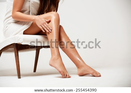 Long Woman Legs . Beautiful Woman Cares About Legs. Depilation - stock photo