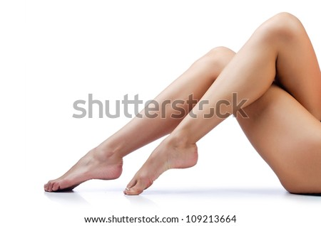 Long woman legs isolated on white - stock photo