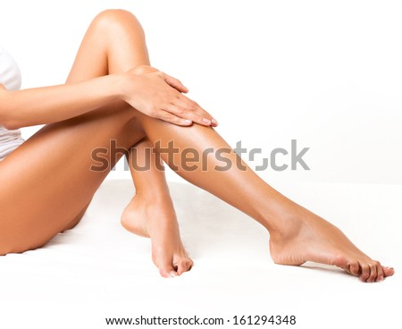 Long Woman Legs isolated on white. Depilation - stock photo