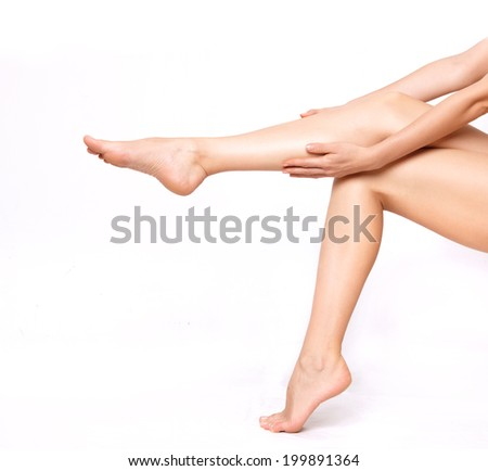 Long woman legs isolated on white. Depilation or another healths concept