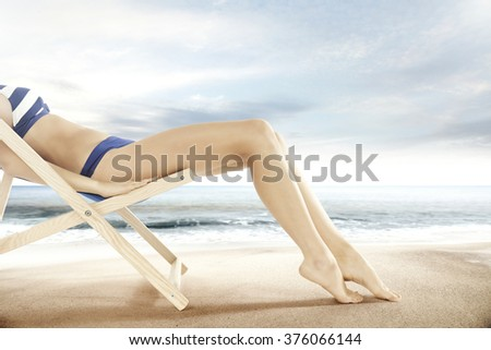 long woman legs on chair and beach landscape