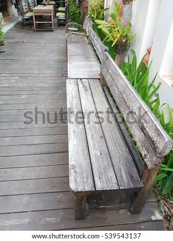 long wood bench in the restaurant open air in the park