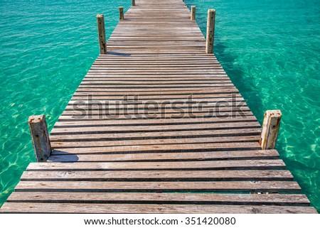 Long wooden bridge in beautiful tropical island beach - Koh Kood, Trat Thailand - stock photo