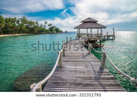 Long wooden bridge pavilion in beautiful tropical island beach - Koh Kood, Trat Thailand - stock photo