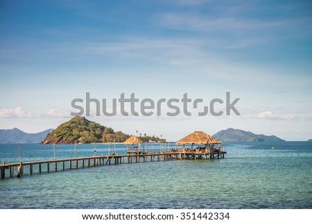 Long wooden bridge pavilion in beautiful tropical island beach - Koh Mak, Trat Thailand - stock photo