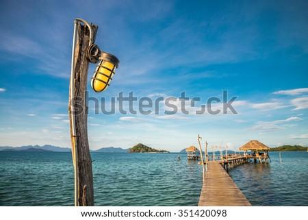 Long wooden bridge pavilion in beautiful tropical island beach - Koh Mak, Trat Thailand - Selective focus - stock photo