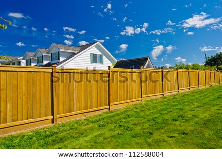 Long wooden fence. - stock photo