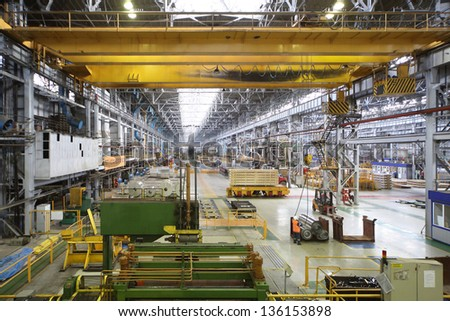 Long workshop with equipment for aluminum rolling - stock photo