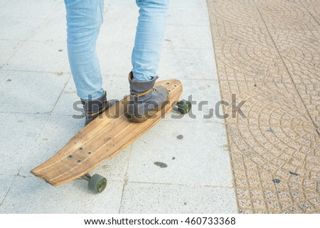 Longboard on a road sunny day