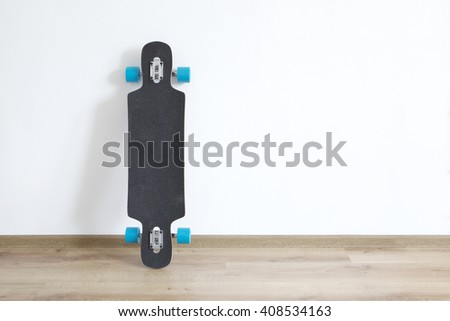 Longboard standing at the wall.