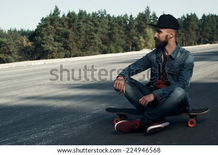 longboarder on the spot in the countryside - stock photo