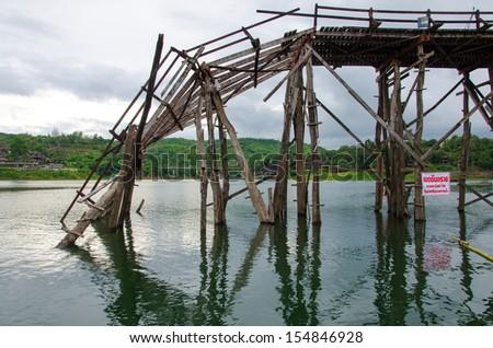 Longest  wooden bridge it broken in Thailand. - stock photo
