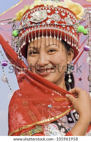 LONGJI-CHINA-SEPT. 16:Unidentified Zhuang minority girl on Sept. 16, 2006 in Longji. Girls of Zhuang minority pose in traditional dress for tourists. With 14 million Zhuang is China's largest minority