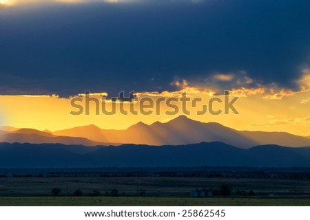 Longs Peak during sunset as seen from the easter plains outside of Denver, Colorado - stock photo