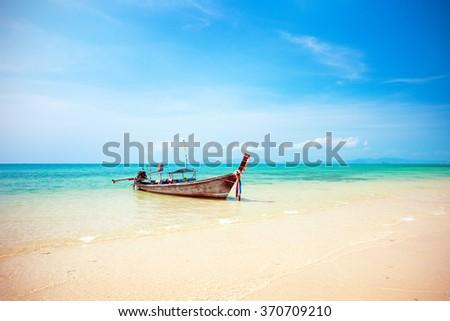 longtail boat and beautiful beach - stock photo