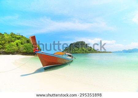 Longtail boat at famous sunny Long Beach, Krabi Thailand, Andaman sea - stock photo