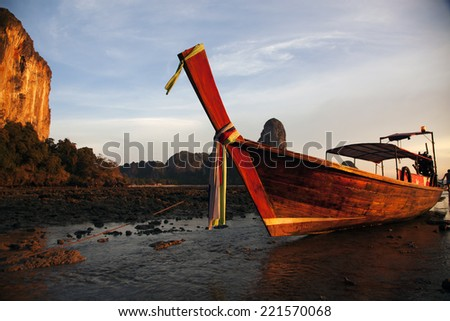 Longtail boat at sunset at Railay beach, Thailand  - stock photo