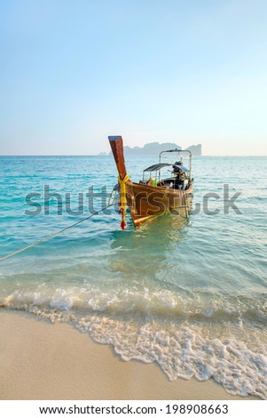 Longtail boat at the tropical beach of Poda island, Andaman sea, Thailand