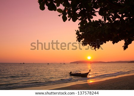 Longtail boat in Andaman sea at sunset, Thailand - stock photo