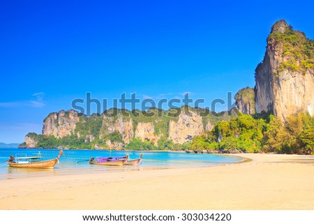 Longtail boats at the west Railay beach - stock photo