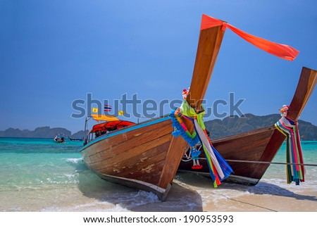 Longtail boats landing in Phi-Phi Island, Thailand