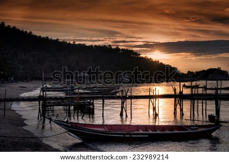 Longtail boats on seashore at sunset, Thailand - stock photo