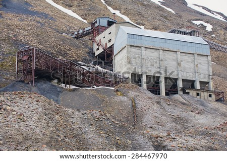 LONGYEARBYEN, NORWAY - SEPTEMBER 01, 2011: Exterior of the abandoned arctic coal mine buildings in Longyearbyen, Norway. - stock photo