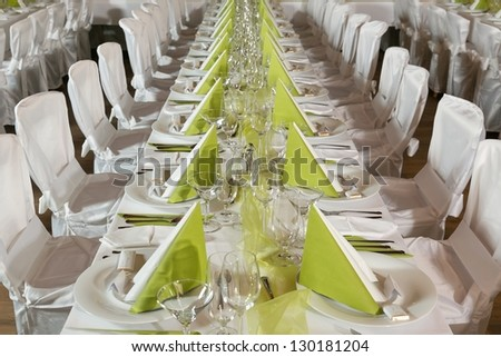 Look at the tables prepared for the celebration in a restaurant - stock photo