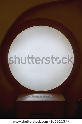Look of a round window in a hotel, as an interior decoration.