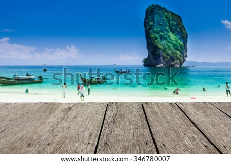 Look out from the old wood table, blur image of the island in Krabi , Thailand as background.