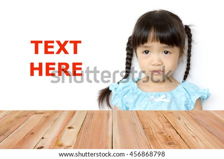 Look out from the table, Asian girl sad as background.(Space left for text input .) - stock photo