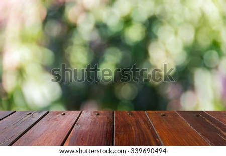 Look out from the table, beautiful bokeh use as a background or use for product presentation related Images. - stock photo