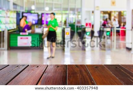 Look out from the table, blur image of check point in building as background. - stock photo