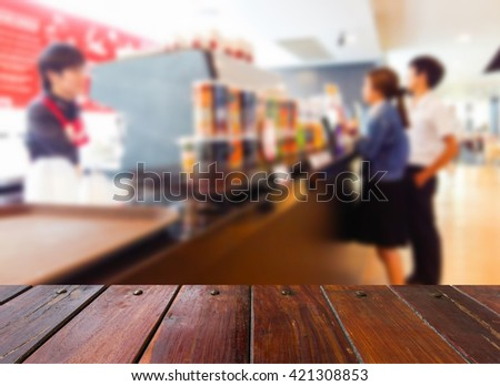 Look out from the table , blur image of coffee shop as background.
