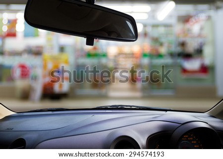 Look out the car window to see the convenience store ,use for product presentation related Images.