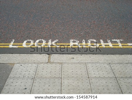 Look right. London pedestrian street sign. - stock photo