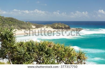 Looking across Frenchmans Beach on North Stradbroke Island toward Deadmans Beach, in Queensland, Australia - stock photo
