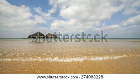 Looking across the beach at Holiwell Bay, Conrwall - stock photo
