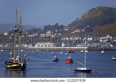 Looking across the River Conwy from Conwy to the town of Deganwyon the north Wales coast in the United Kingdom. - stock photo