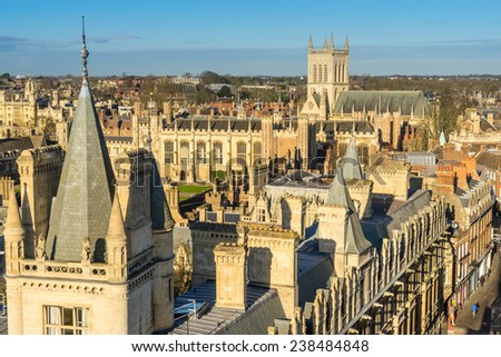looking across the rooftops of the university city of Cambridge in the UK - stock photo