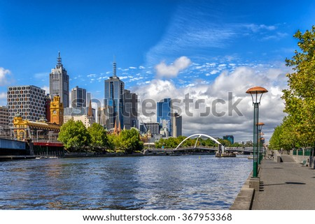 Looking across the Yarra River from Southbank to Melbourne CBD - stock photo