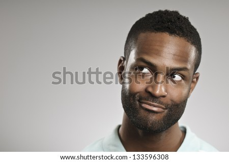 Looking Away With A Smile - stock photo