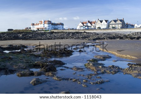 Looking back at hotels on Porthcawl seafront from beach at low tide. South Wales, UK.
